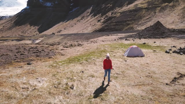 Young woman enjoying camping alone in Iceland, drone point of view