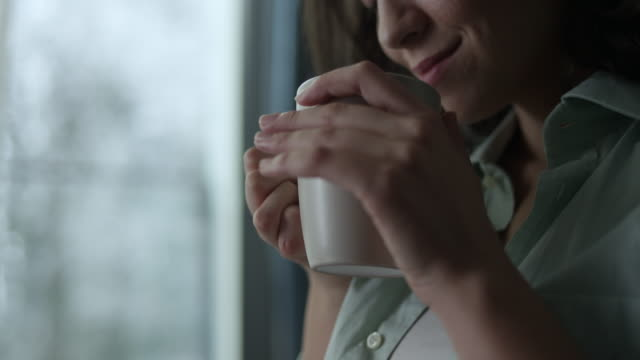 young woman enjoying coffee - satisfaction stock videos & royalty-free footage