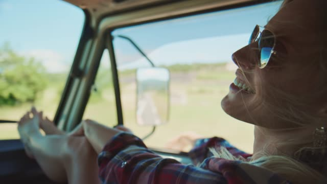 young woman enjoying during road trip - indicare video stock e b–roll