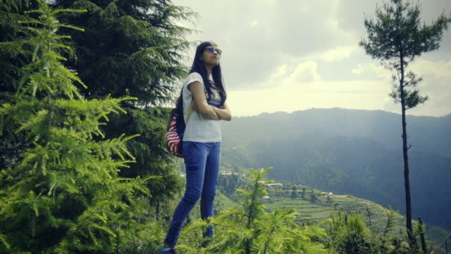 Young woman enjoying fresh air in hills.