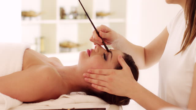 young woman enjoying head massage - spa treatment stock videos & royalty-free footage