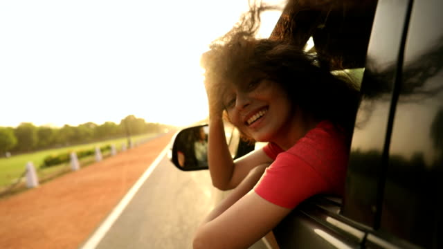 Young woman enjoying in the car, Delhi, India