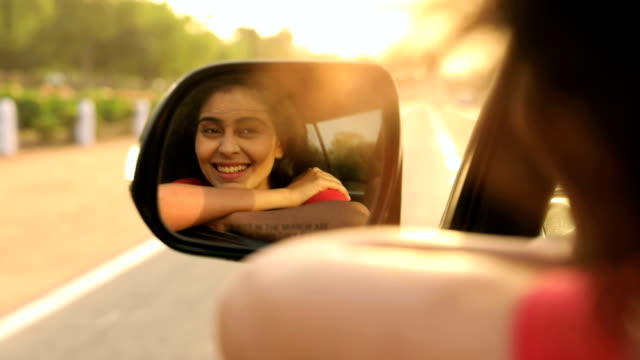 young woman enjoying in the car, delhi, india - specchio video stock e b–roll