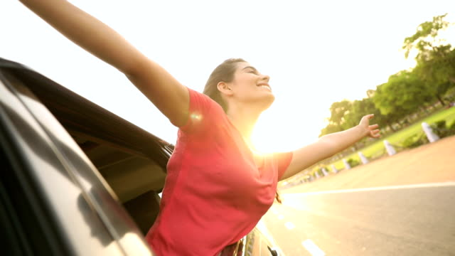 young woman enjoying in the car, delhi, india - arms outstretched stock videos and b-roll footage