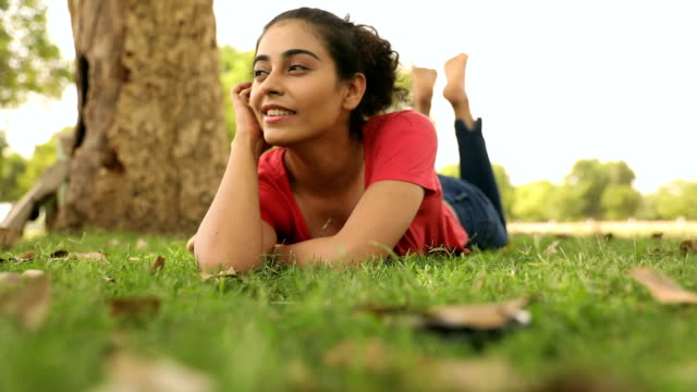 young woman enjoying in the park, delhi, india - serene people stock videos & royalty-free footage