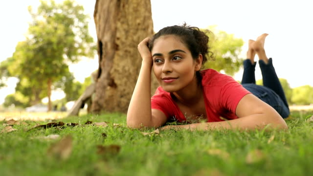 young woman enjoying in the park, delhi, india - lying on front stock videos & royalty-free footage