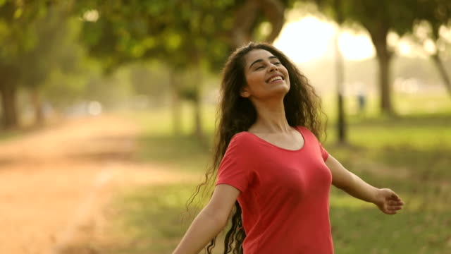 young woman enjoying in the park, delhi, india - long stock videos & royalty-free footage