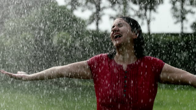 young woman enjoying in the rain season, delhi, india - arms outstretched stock videos and b-roll footage