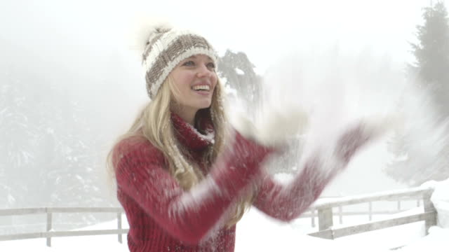 stockvideo's en b-roll-footage met young woman enjoying in winter with blowing snow - coltrui