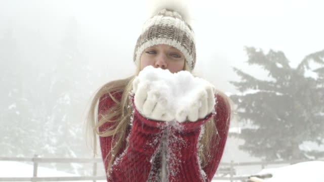 young woman enjoying in winter with blowing snow - pullover stock videos & royalty-free footage