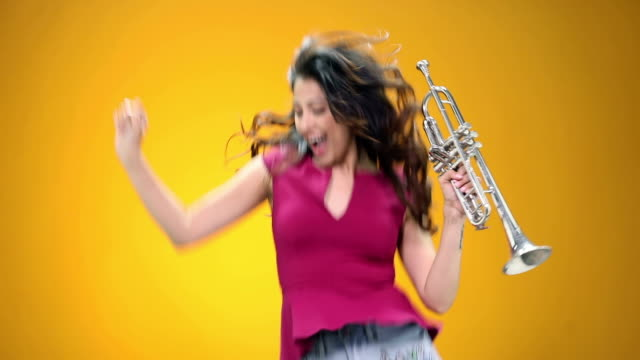 young woman enjoying music - trumpet stock videos and b-roll footage