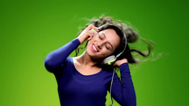 Young woman enjoying music