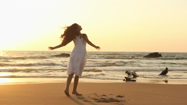 young woman enjoying on the beach  - exhilaration stock videos & royalty-free footage