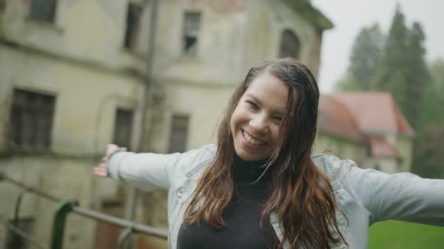 young woman enjoying rain on bridge - wet hair stock videos & royalty-free footage