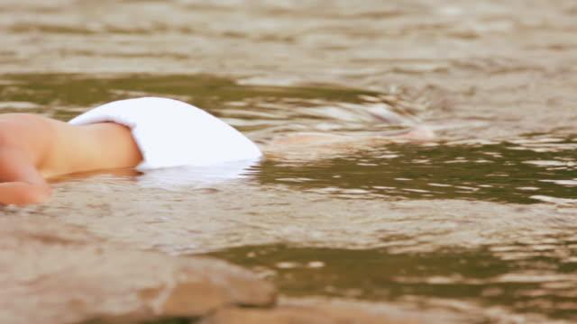 Young woman enjoying spa treatment at riverbank, Kerala, India