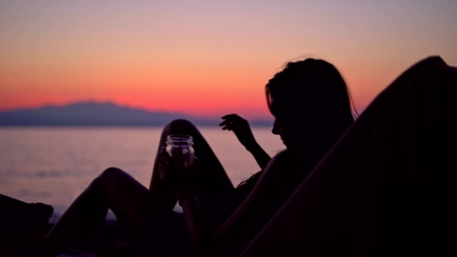 young woman enjoying sunset on the beach - negative emotion stock videos & royalty-free footage