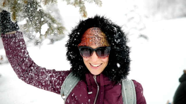young woman enjoys snowy winter day - extreme terrain stock videos & royalty-free footage