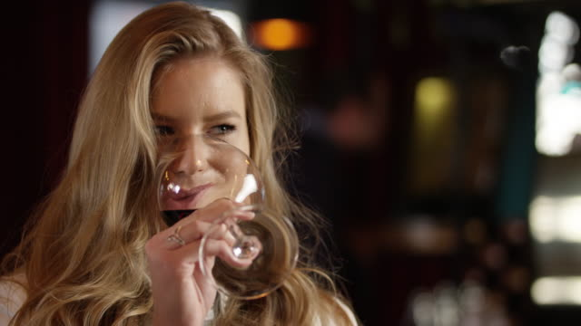 Young Woman Enjoys With Glass of Red Wine 4K slow motion