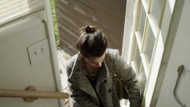 ms ha young woman entering house / provo, utah, usa - eintreten stock-videos und b-roll-filmmaterial