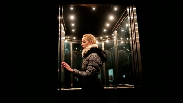 A young woman enters in the elevator