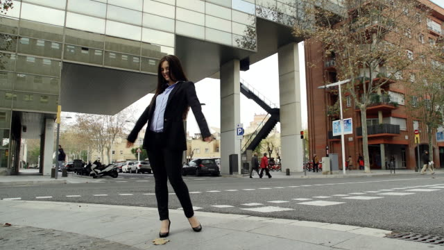 young woman executive dancing in the street. - all shirts stock videos & royalty-free footage
