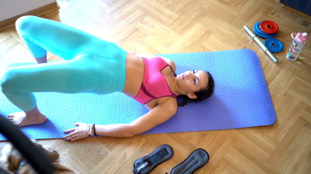 young woman exercises on floor - pilates stock videos & royalty-free footage