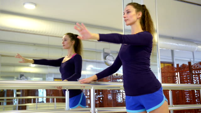 young woman exercising before the dance class - barre stock videos and b-roll footage