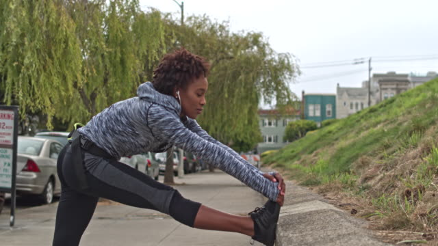 young woman exercising outdoors in san francisco - relaxation exercise stock videos and b-roll footage