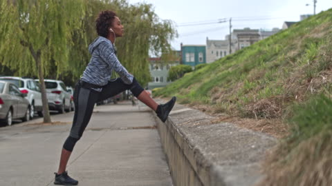 young woman exercising outdoors in san francisco - stretching stock videos & royalty-free footage
