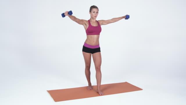 ws young woman exercising with dumbbells / orem, utah, usa - orem utah stock videos & royalty-free footage