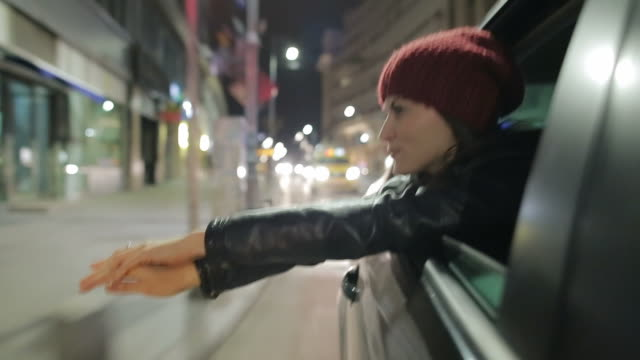 young woman experiences freedom on the city streets. - after work stock videos & royalty-free footage
