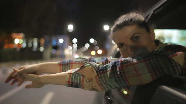 Young woman experiences freedom on the city streets.