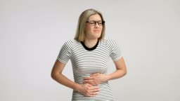 Young woman experiencing stomach pain