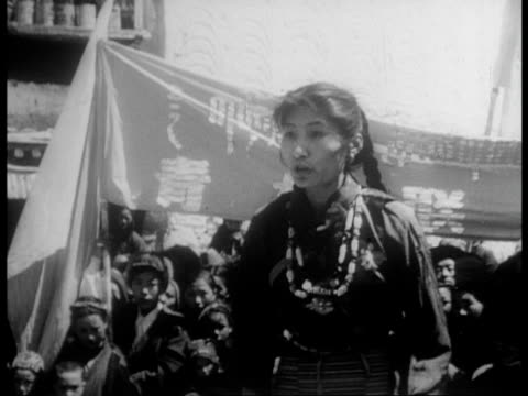 young woman explains the commitees decisions to the people of lhasa / the people repair and rebuild / schools are reopened / students learning in... - rebellion stock videos & royalty-free footage