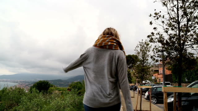 young woman explores mediterranean coastal zone - pants stock videos and b-roll footage