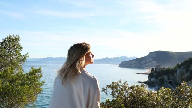 Young woman explores Mediterranean coastal zone