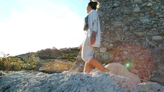 young woman explores mediterranean coastal zone - italian flag stock videos and b-roll footage