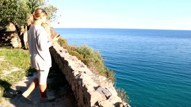 Young woman explores Mediterranean coastal zone