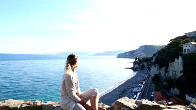 young woman explores mediterranean coastal zone - pedal pushers stock videos & royalty-free footage
