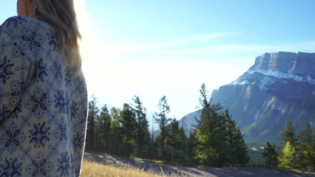 young woman exploring in a mountain setting - cardigan sweater stock videos & royalty-free footage