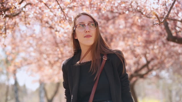 young woman exploring spring - serene people stock videos & royalty-free footage