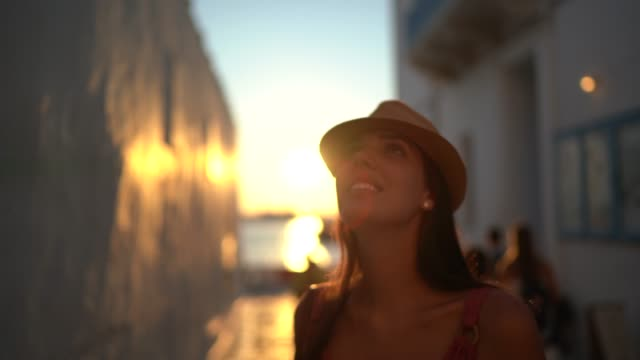 young woman exploring the streets of mykonos, greece - mykonos stock videos & royalty-free footage