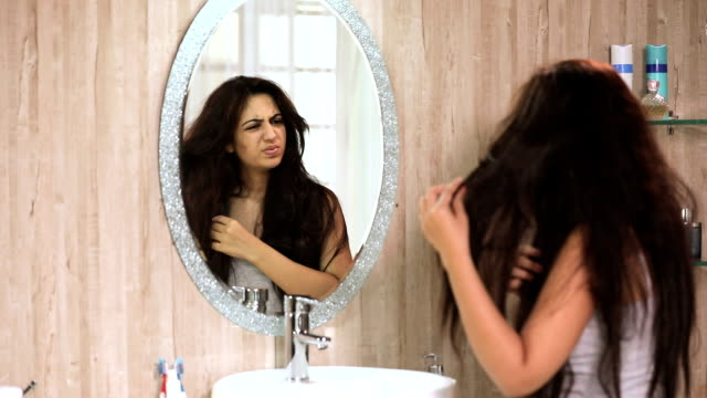 Young woman facing hair problem, Delhi, India