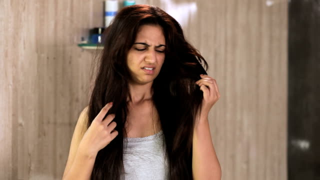 young woman facing hair problem, delhi, india - tangled stock videos & royalty-free footage
