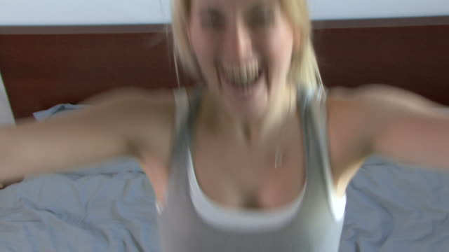 young woman falling onto bed, uk - head back stock videos & royalty-free footage