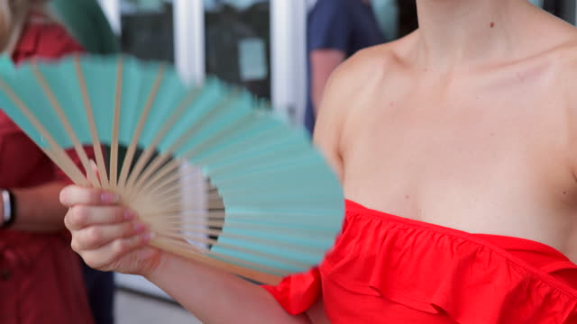 young woman fanning in the sun - hand fan stock videos and b-roll footage
