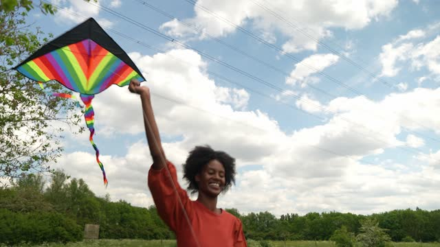 young woman flying kite in countryside - spectrum stock videos & royalty-free footage