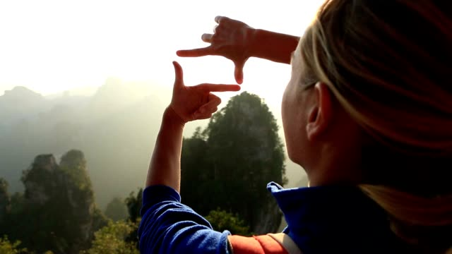 Young woman framing nature