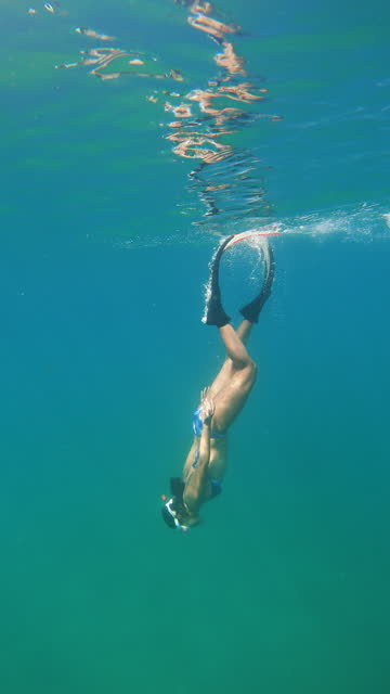 4k young woman free diver wear long fins freediving skindiving snorkeling in the sea - aqualung diving equipment stock videos & royalty-free footage