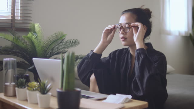young woman freelancer working home - show home stock videos & royalty-free footage